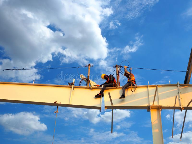 Man Working on the Working at height. On blue sky royalty free stock photography