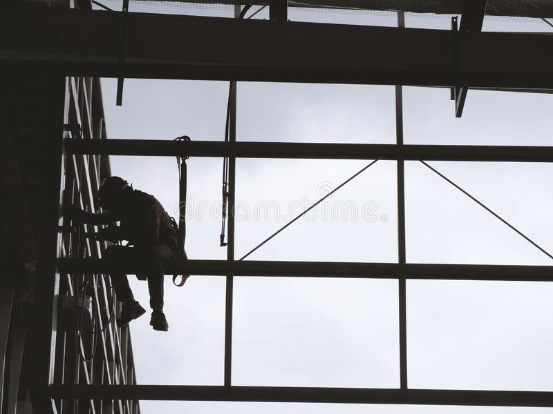 Man Working on the Working at height. On Construction Site royalty free stock image