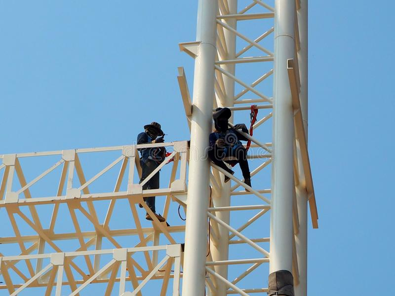 Man Working on the Working at height stock images