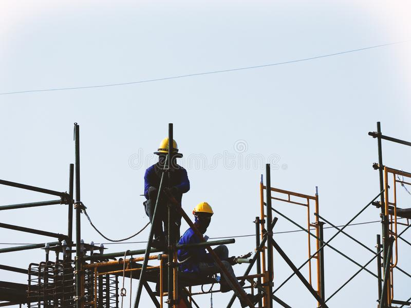 Man Working on the Working at height. On Construction Site royalty free stock photos