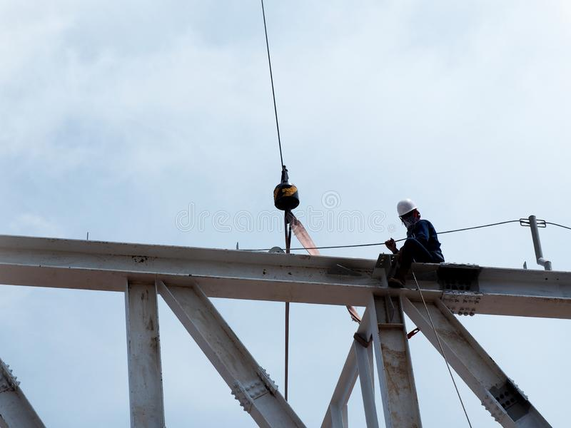 Man Working on the Working at height. On Construction Site stock images