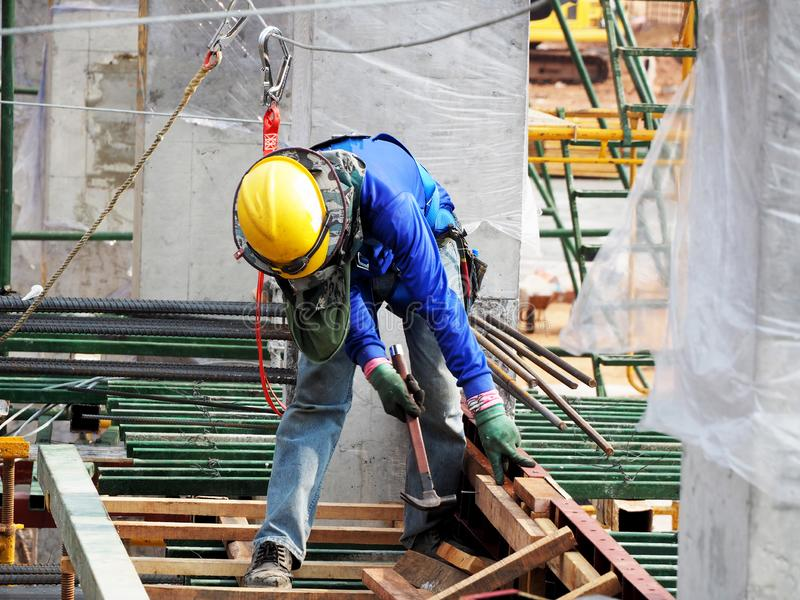 Man Working on the Working at height. On Construction site stock photo