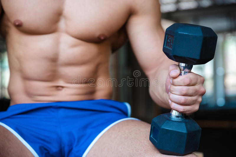 Man workout holding dumbbell royalty free stock photography