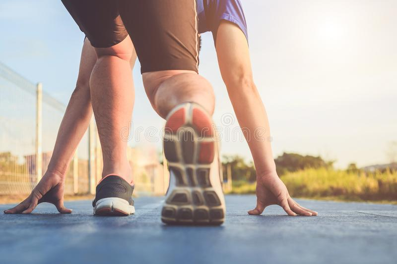 Man workout and wellness concept : Runner feet with sneaker shoe. Man workout and wellness concept : Close up runner feet with sneaker shoe running on road in stock photos