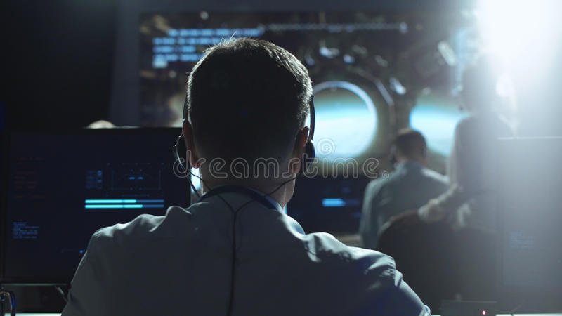 Man at workplace in space center royalty free stock photo