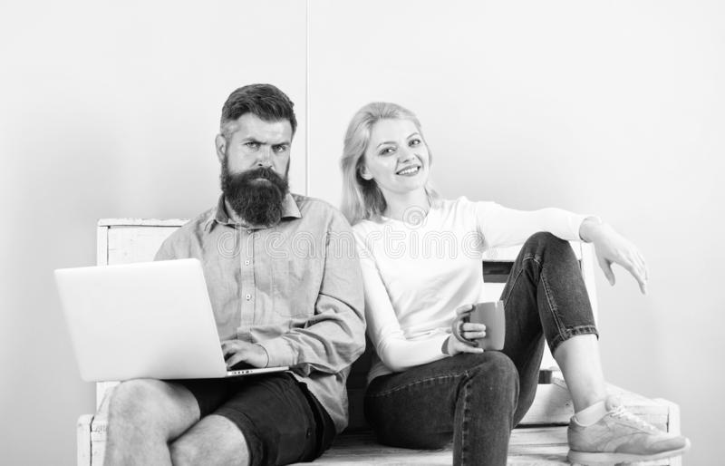 Man works as internet technologies expert on freelance. Freelance benefits. Girl enjoy drink while husband freelancer stock image