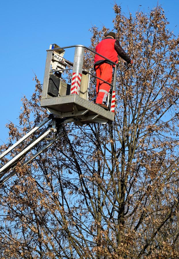 Man works in the high lift outdoor. N royalty free stock photo