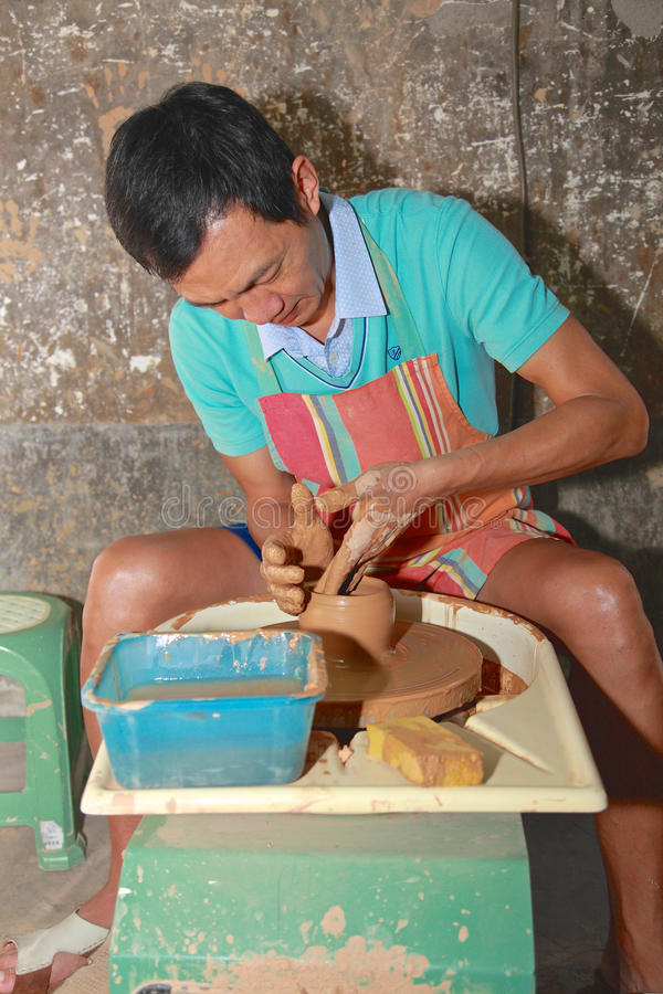 Man works on pottery wheel,Taibei,Taiwan. stock images