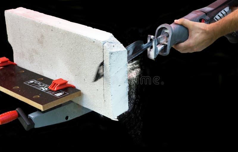 Man works with saber saw. Close up stock photos