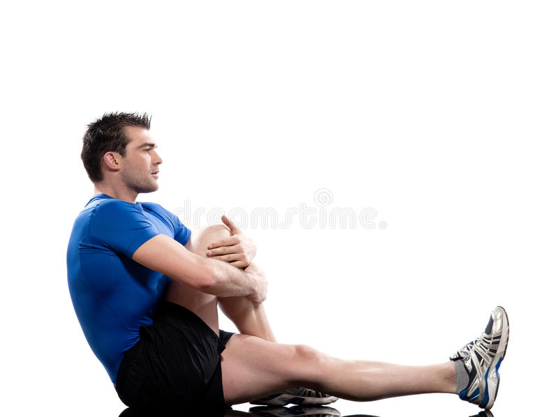 man Worrkout Posture Yoga Marichyasana stretching workout posture by a man on studio white background stock photography