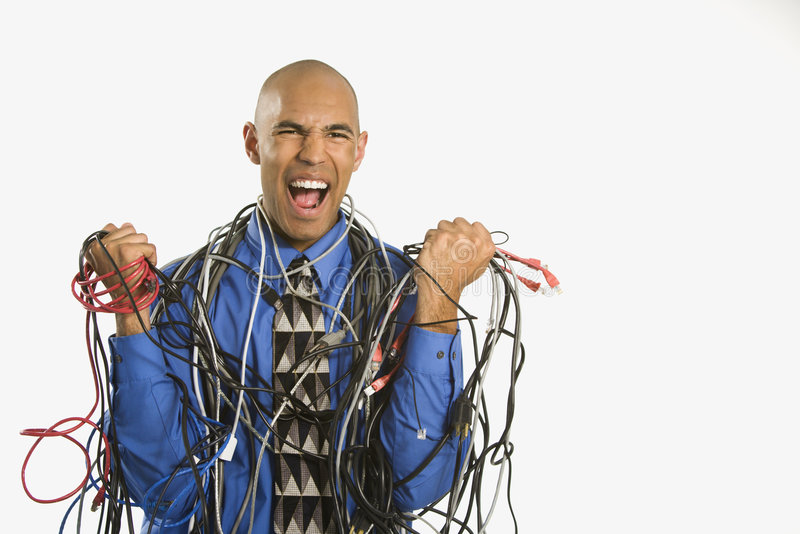 Man wrapped in cables. stock photography