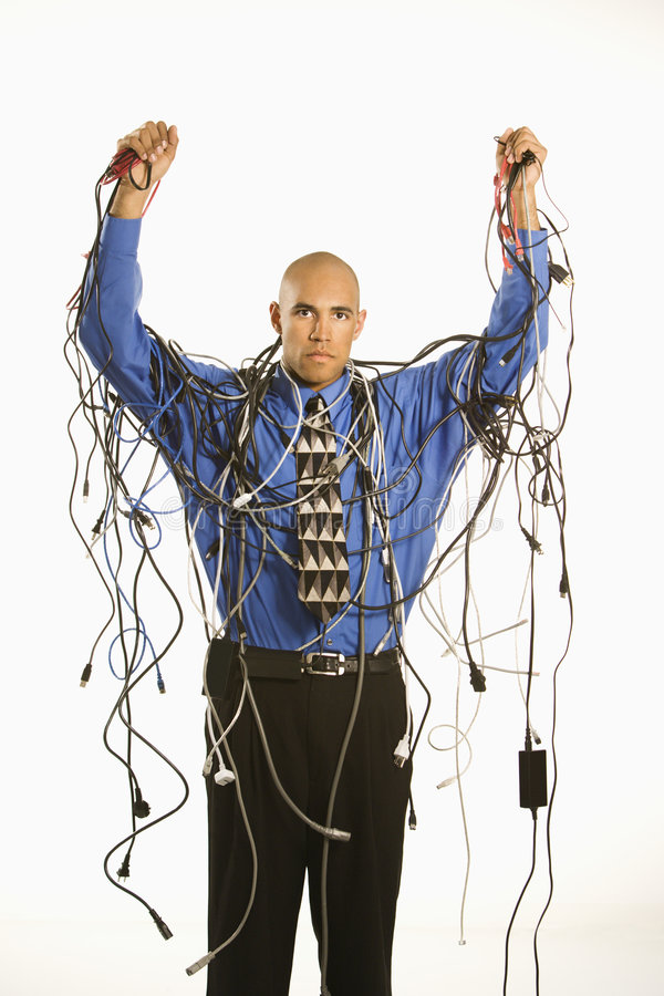 Download Man wrapped in cables. stock photo. Image of overworked - 2431814
