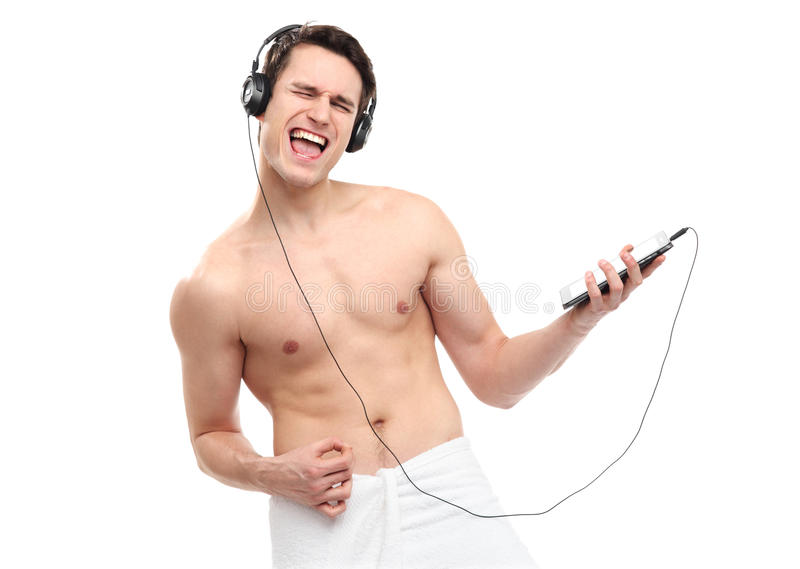 Download Man Wrapped In Towel Listening To Music Stock Photo - Image: 29073622