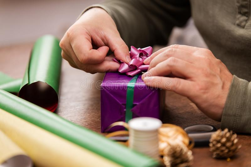 Man is wrapping colorful gifts royalty free stock photos