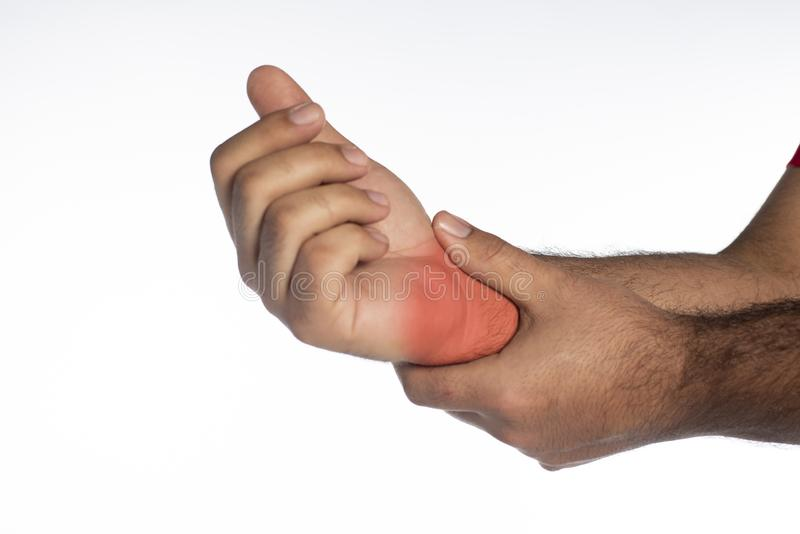 Man with wrist pain. Signaled in red stock image