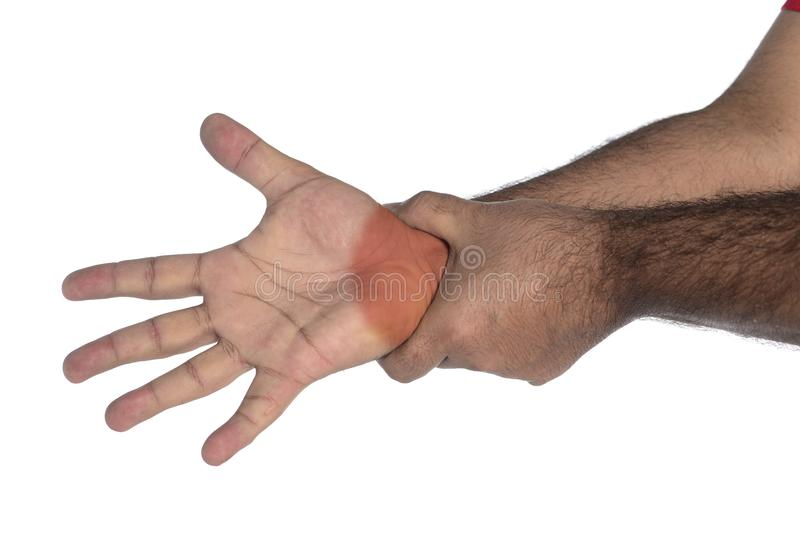 Man with wrist pain. Signaled in red, young, stretching, cramp, illness, anatomy, body, muscle, injury, human, hand, touching, one, health, medicine, ache royalty free stock photos