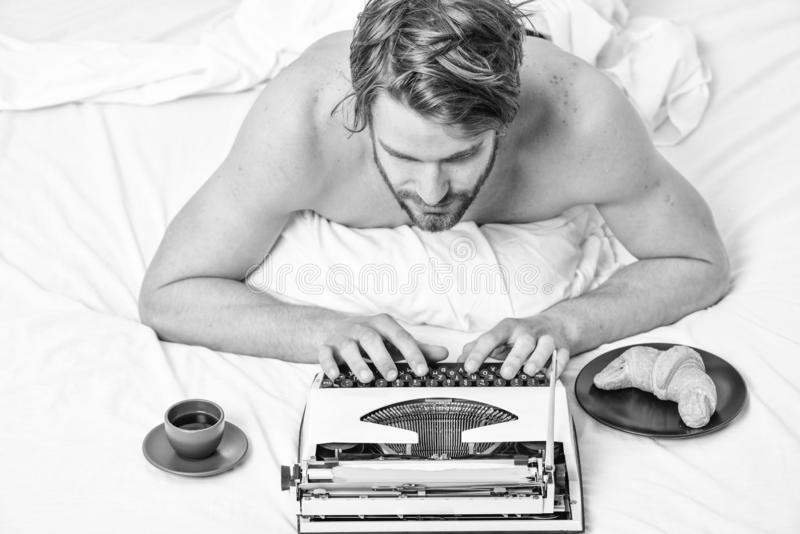 Man writer lay bed with breakfast working. Morning bring fresh idea. Morning inspiration. Erotic literature. Daily. Routine of writer. Writer handsome author stock images