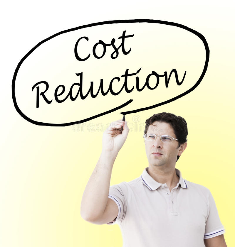 Man writing `Cost Reduction` stock photography