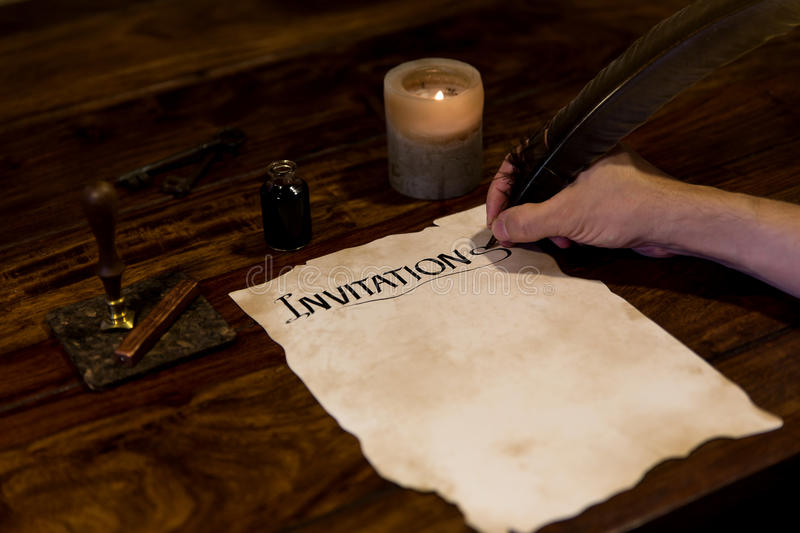 Man is writing on a document Invitation stock photo