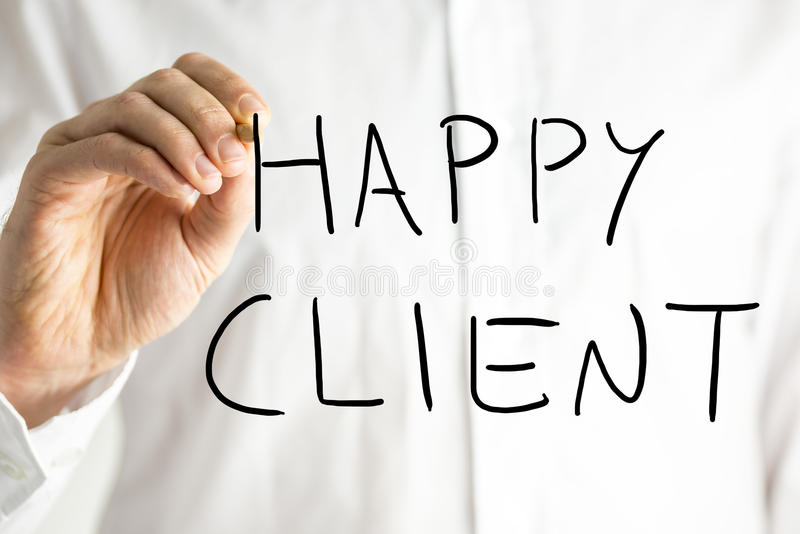 Man writing Happy Client on a virtual screen stock photo