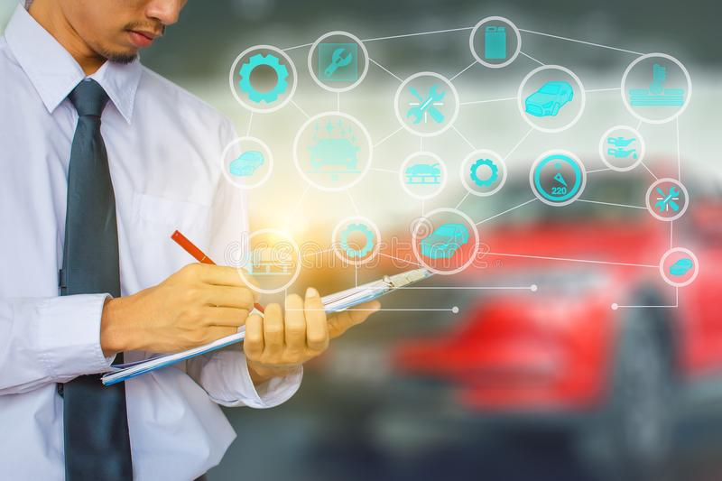 Man writing note on car engine blurry background. for note, tran royalty free stock photos