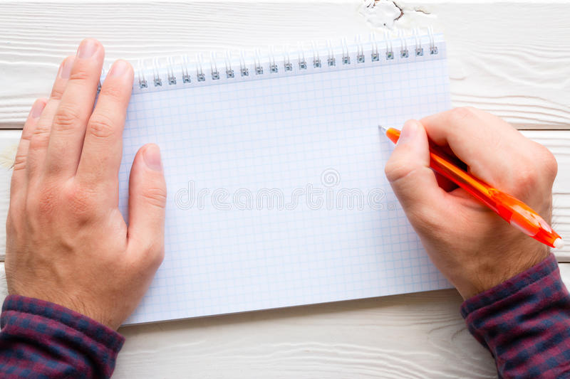 Man writing in a notebook royalty free stock photos