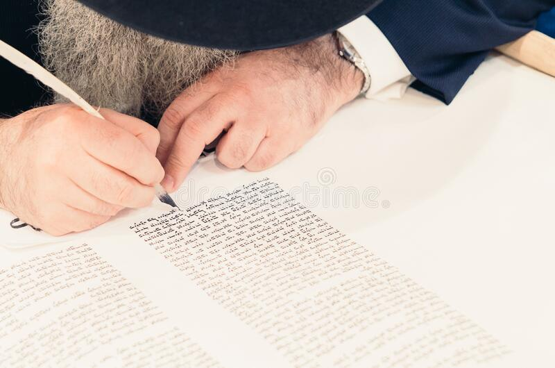 Man writing with quill pen stock images