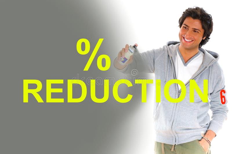 Man writing reduction prices royalty free stock image