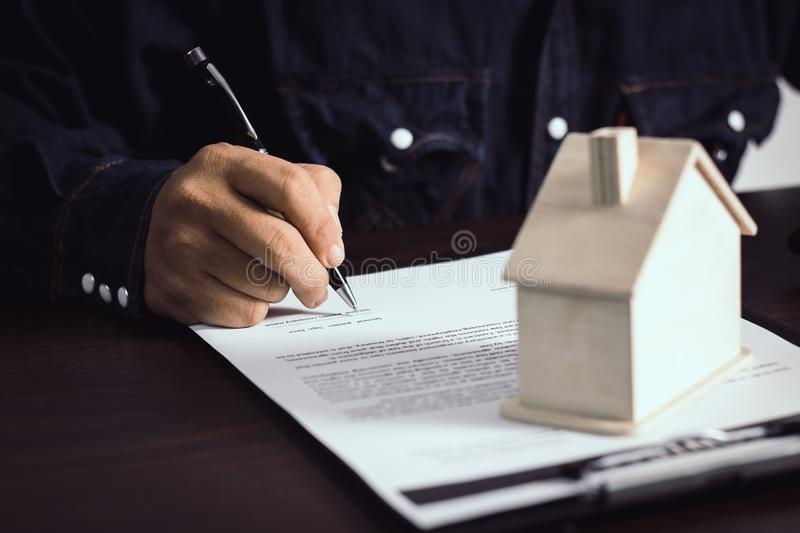 man writing and sign on contract of house after finishing selling and buying home royalty free stock images