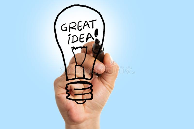 Man writing text inside lighbulb drawing royalty free stock images