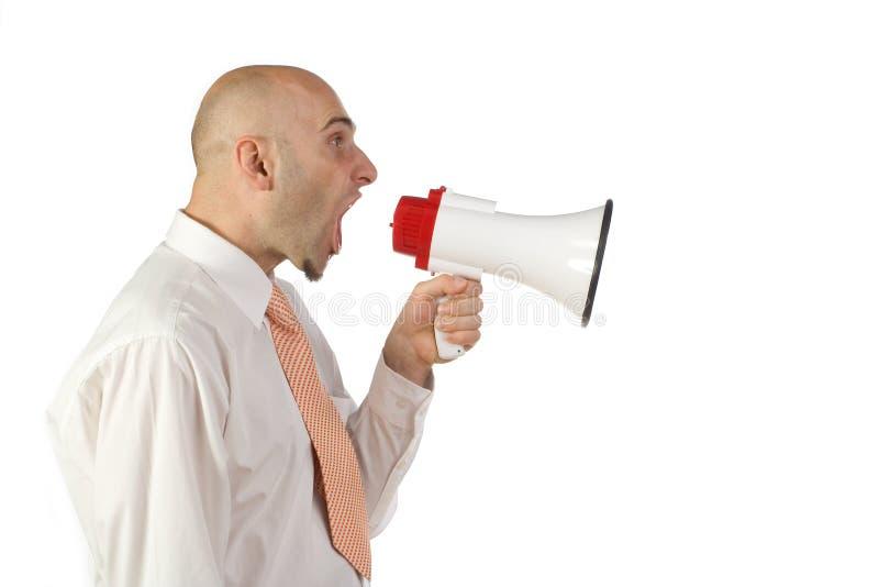 Man yelling into bullhorn royalty free stock photos
