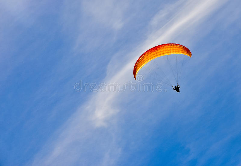 Man with yellow parachute royalty free stock image