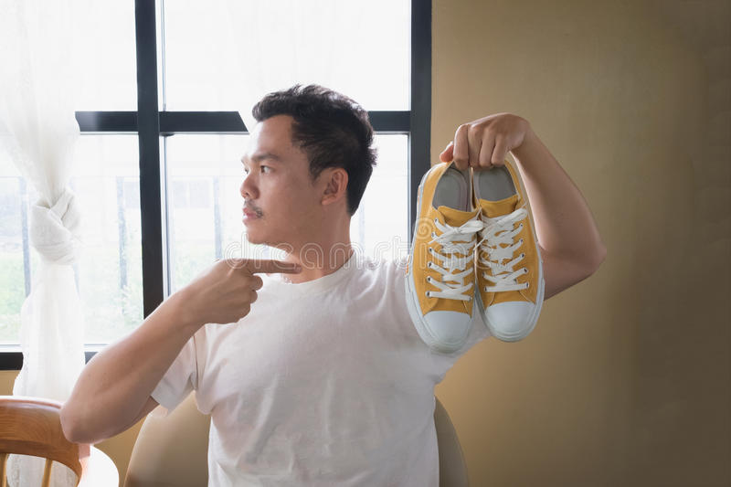 A man and yellow sneakers royalty free stock photo