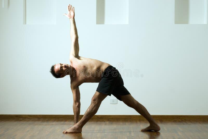Man in a Yoga Pose - Horizontal royalty free stock photos