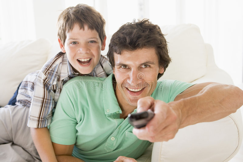 Man and young boy with remote control stock photo