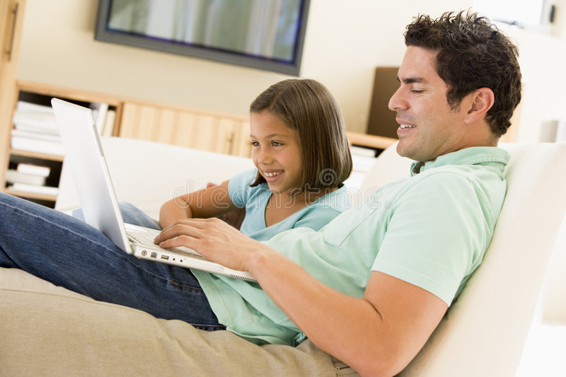 Download Man With Young Girl In Living Room With Laptop Stock Image - Image: 5931095