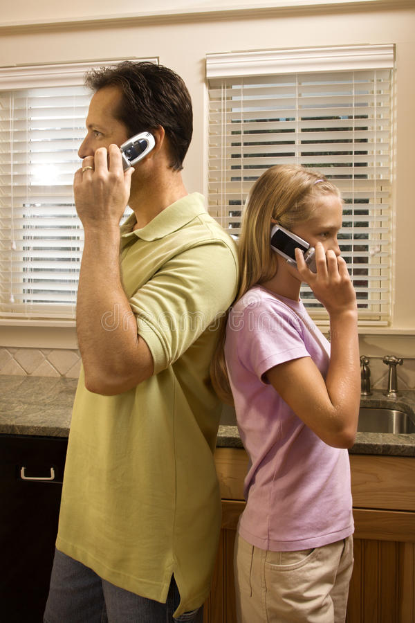 Download Man And Young Girl On Phones Stock Photo - Image of casual, brunette: 12543744