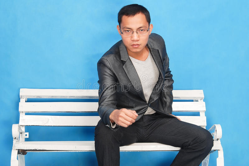 Man. Young man sitting in a chair stock images