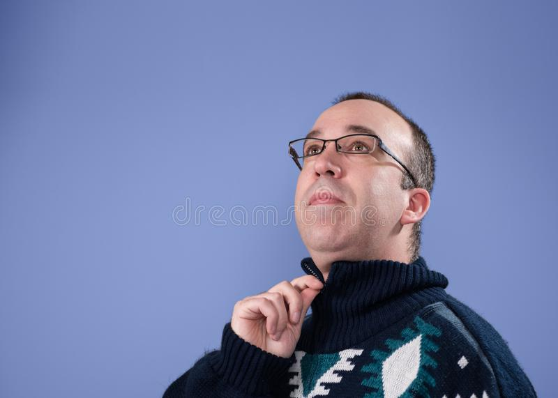 Man zipping up his sweater stock image