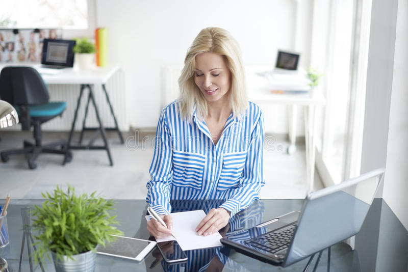 Manage her business stock photos