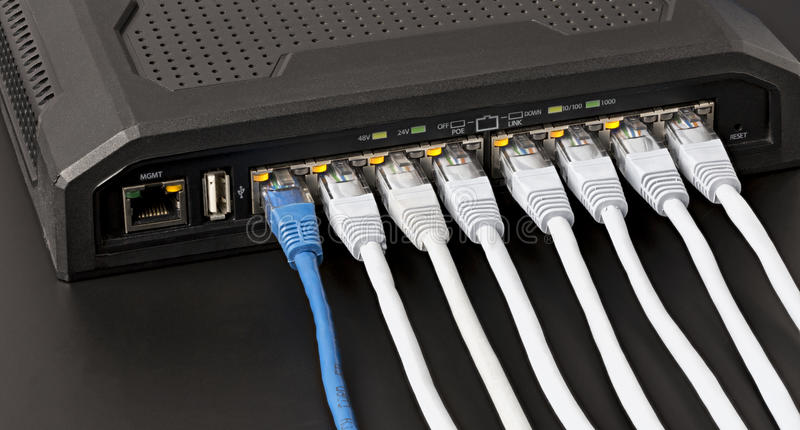 Managed lan switch with 10 power over ethernet gigabit ports royalty free stock photography