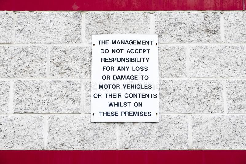 Management accept no responsibility for loss of contents or damage to motor vehicles sign. Uk stock photos
