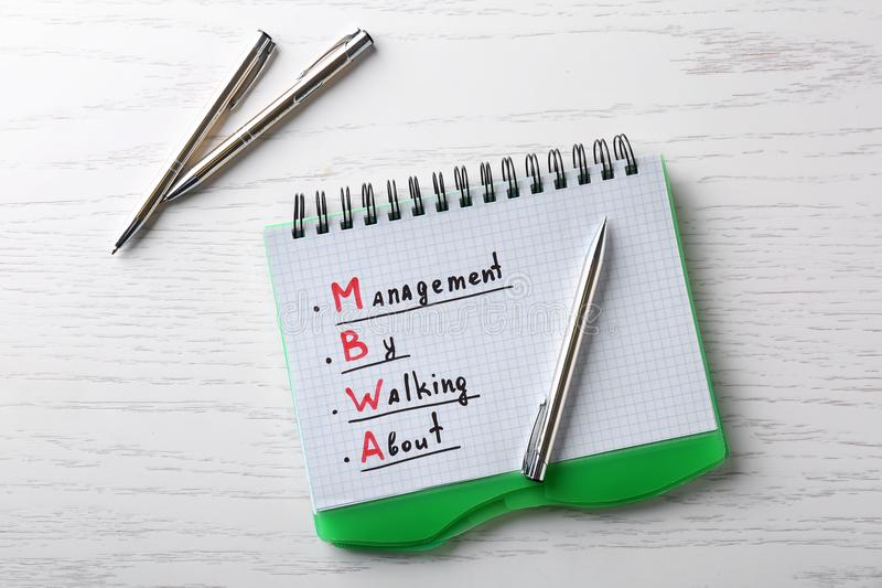 Management concept. Notepad and pens on wooden table royalty free stock photography
