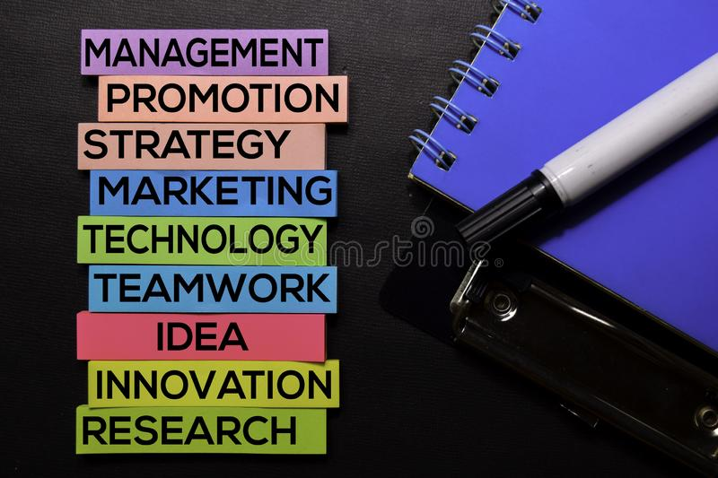 Management, Promotion, Strategy, Marketing, Technology, Teamwork, Idea, Innovation, Research text on sticky notes isolated on. Black desk. Mechanism Strategy stock photo