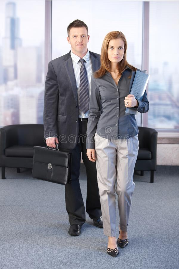 Manager and assistant going to business meeting royalty free stock photos