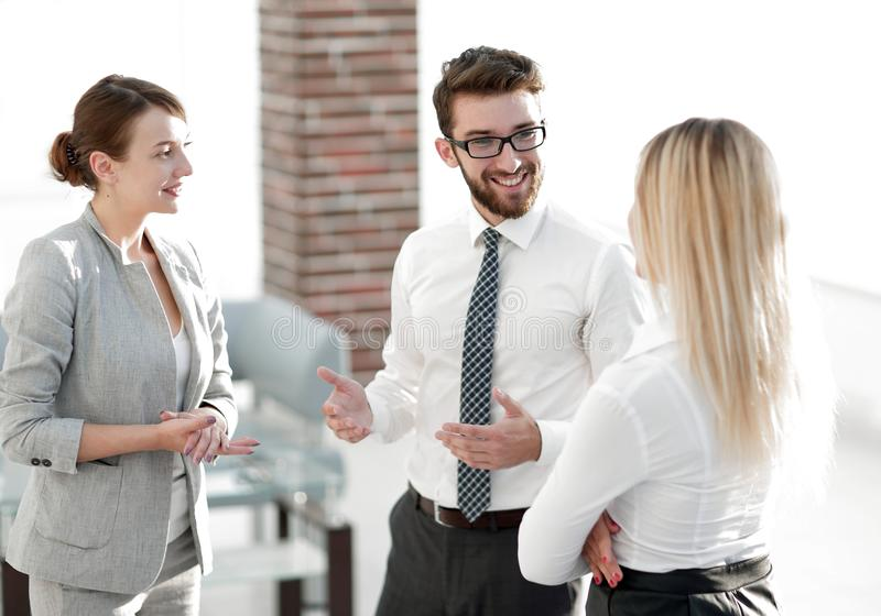Manager and business team talking in the office. Photo with scopy space stock image