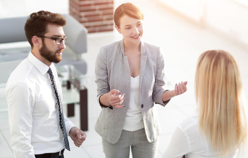 Manager and business team talking in the office. Photo with scopy space stock photo