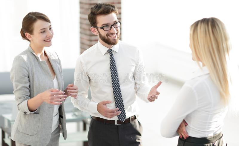 Manager and business team talking in the office. Photo with scopy space stock photography