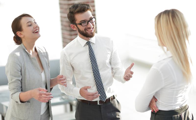 Manager and business team talking in the office. Photo with scopy space royalty free stock image
