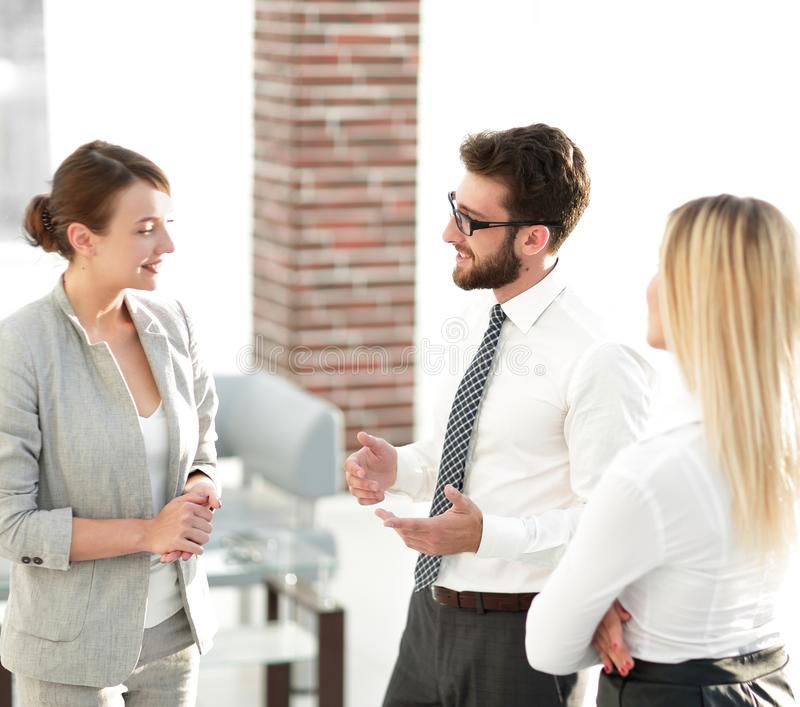 Manager and business team talking in the office. Photo with scopy space royalty free stock images